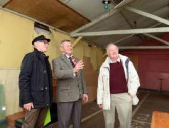Association members Peter Schoutens, State President Carl Schiller and Keith Pitman inside Hut 48, the old officers' mess which they will soon occupy once it has been restored.