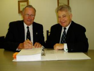 Peter Colliver & Peter Finklestein signing the contract for the purchase of our Hawthorn premises, in October 2005
